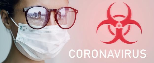 Opieka zdrowotna - kobieta nosząca maskę na twarz z powodu epidemii koronawirusa