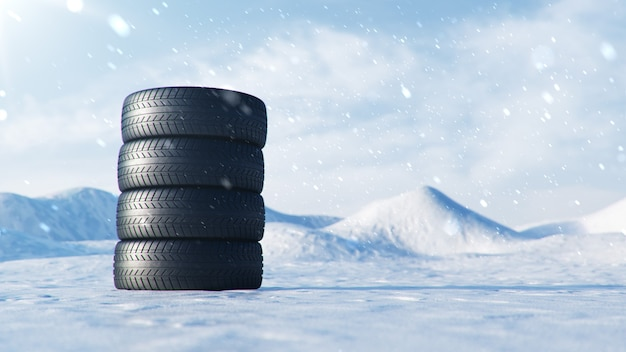 Opony zimowe na tle niebieskiego nieba, opadów śniegu i śliskiej zimowej drodze. koncepcja bezpieczeństwa drogowego zimą