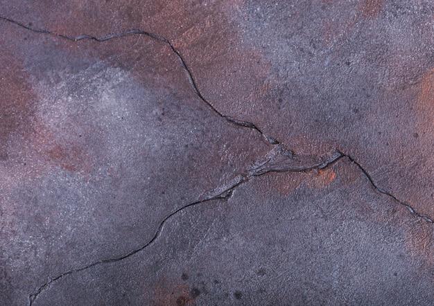 Ośniedziały błękitny purpura cementu betonu kamienia tekstury tło. widok z góry