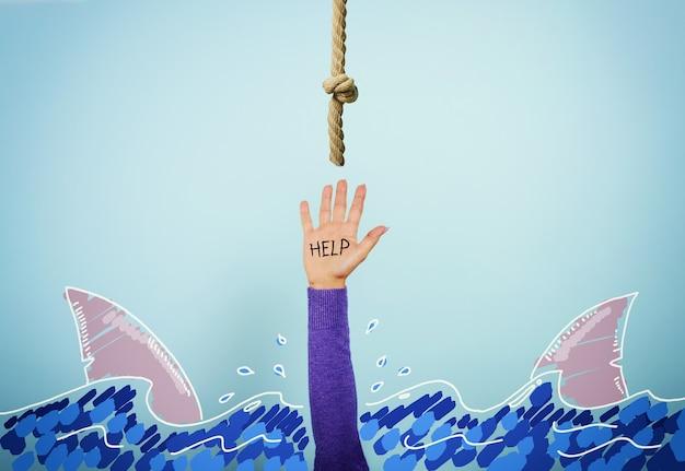 Osoba otoczona rekinami tonie i potrzebuje pomocy. pojęcie kryzysu i problemu