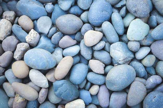 Otoczaka kamienny tło z rocznika filtrem