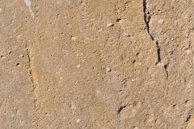 Otynkowane tło ściany lub tekstura