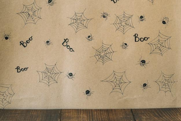 Ozdobny na zdjęciu pająki z pajęczyną i napisem