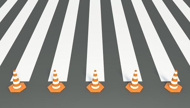 Pachołki drogowe na podłodze przejścia dla pieszych.