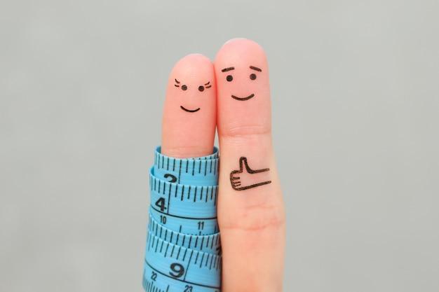 Palce sztuki szczęśliwej pary z centymetrem. koncepcja utraty wagi razem.