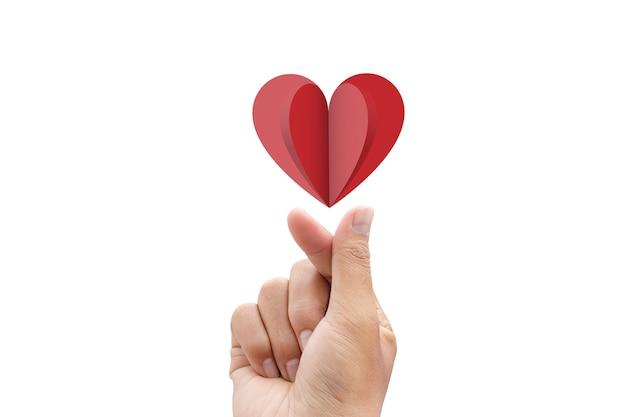Palcowy kierowy gest i czerwieni papierowy serce odizolowywający
