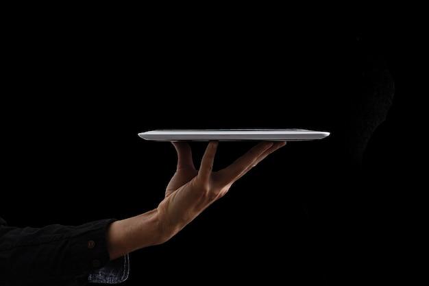 Palec Dotykający Podświetlanego Ekranu Cyfrowego Tabletu Premium Zdjęcia