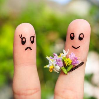 Palec sztuki pary. mężczyzna daje kobiecie bukiet kwiatów