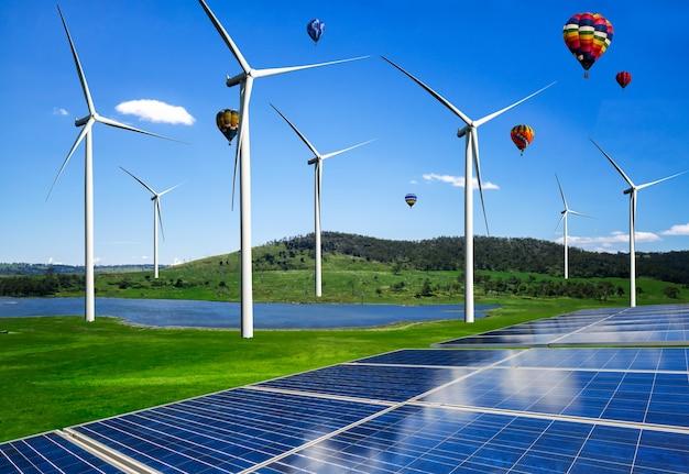 Panel energii słonecznej ogniwo fotowoltaiczne i generator energii farmy turbin wiatrowych w krajobrazie przyrody