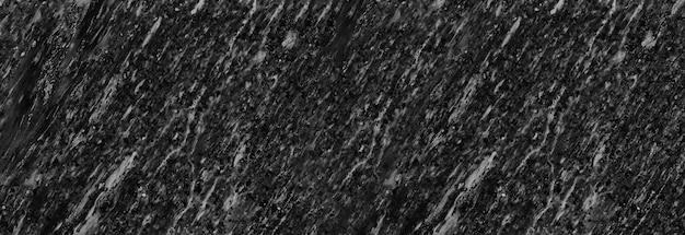 Panorama czarny kamień marmurowy wzór tła ściany do projektowania w swojej pracy.
