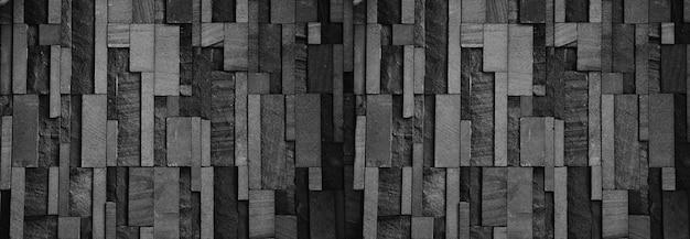 Panorama czarny wzór tła ściany z kamienia do projektowania w twojej pracy.