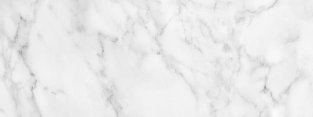 Panorama z białego marmuru kamienia tekstury na tle lub luksusowe płytki podłogowe i tapety dekoracyjne.