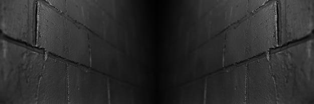 Panoramiczny widok banera; streszczenie tło teksturowanej czarnej cegły ściany. koncepcja perspektywy.