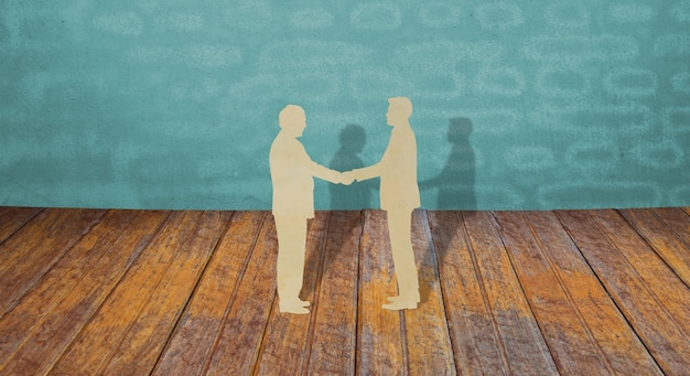 Papercut z dwóch człowiek biznesu wstrząsnąć ręce
