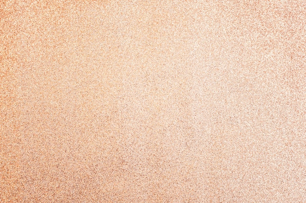 Papier brokatowy brzoskwiniowy, zbliżenie. tło