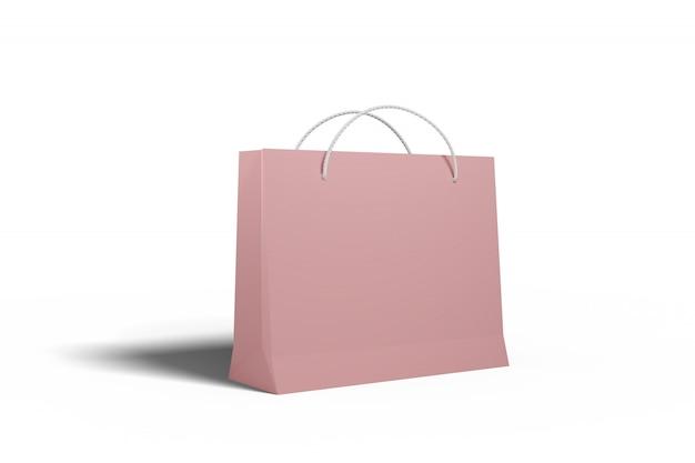 Papierowa torba z tektury na zakupy marchwi w sklepie dyskontowym i na sprzedaż w kolorze różowym rzuca cień na biały izolat.