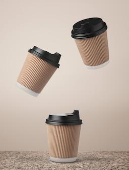 Papierowe kubki do kawy latające nad marmurową powierzchnią na beżowym tle.