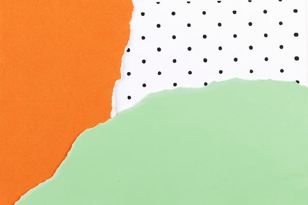Papierowy kolaż w tle z zielonym i pomarańczowym