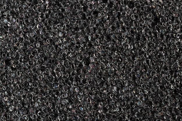 Paralon tekstury z bliska. wysokiej jakości makro tekstura ciemnoszarej gąbki paralon.