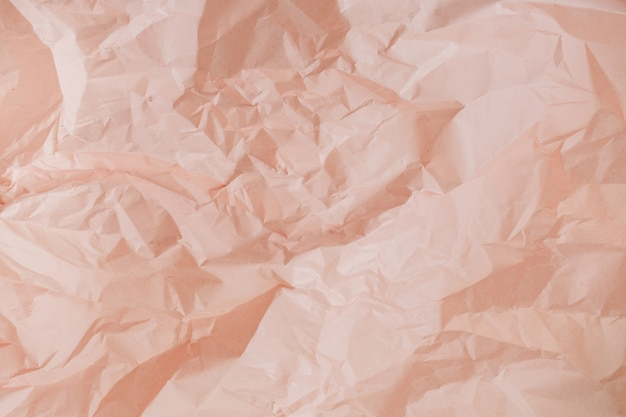 Pastelowa brzoskwiniowa gnieciona tekstura papieru