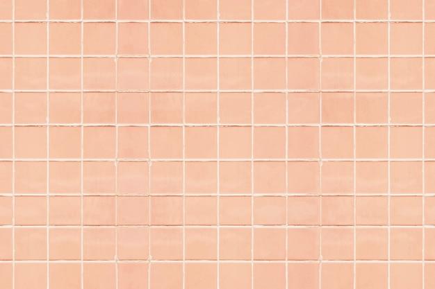 Pastelowe brzoskwiniowe płytki teksturowane tło