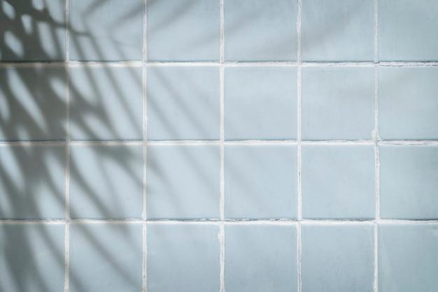 Pastelowe niebieskie płytki teksturowane tło
