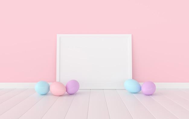 Pastelowe różowe pisanki i makiety rama plakatowa na białej drewnianej podłodze.