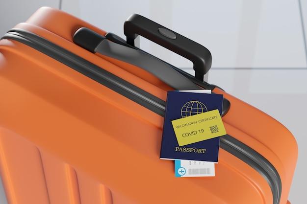 Paszport i karta szczepień covid 19 na walizce.
