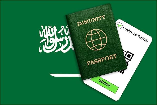 Paszport immunitetu na podróż po pandemii i wynik testu na covid na fladze arabii saudyjskiej