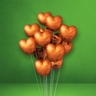 Pęczek balonów w kształcie miedzianego serca na zielonej ścianie. renderowanie 3d