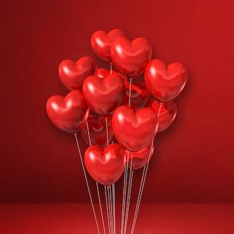 Pęczek balonów w kształcie serca na tle czerwonej ściany. renderowania 3d ilustracji