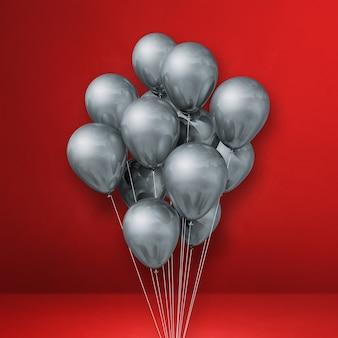 Pęczek srebrnych balonów na czerwonej ścianie. renderowania 3d