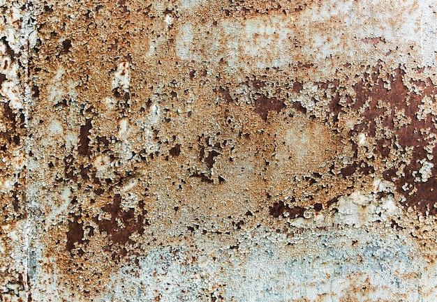 Pęknięta farba stara tekstura na metalu z rdzą. malowana ściana vintage