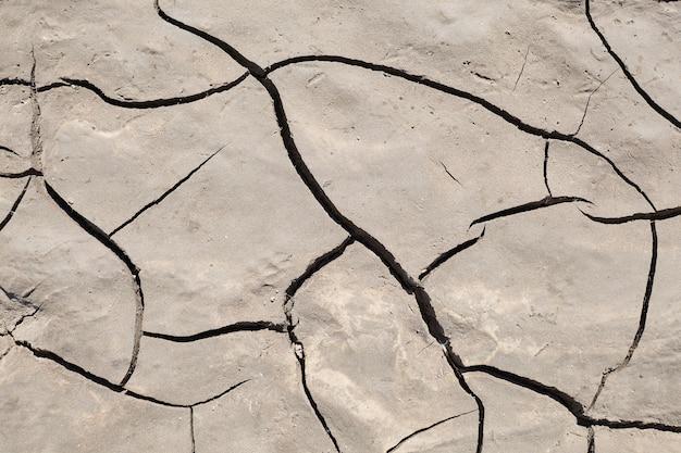 Pęknięta powierzchnia ziemi suche szczegóły gleby