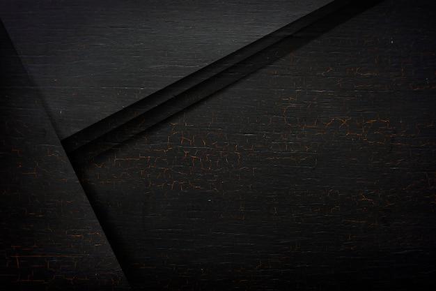 Pęknięte czarne drewniane teksturowane tło