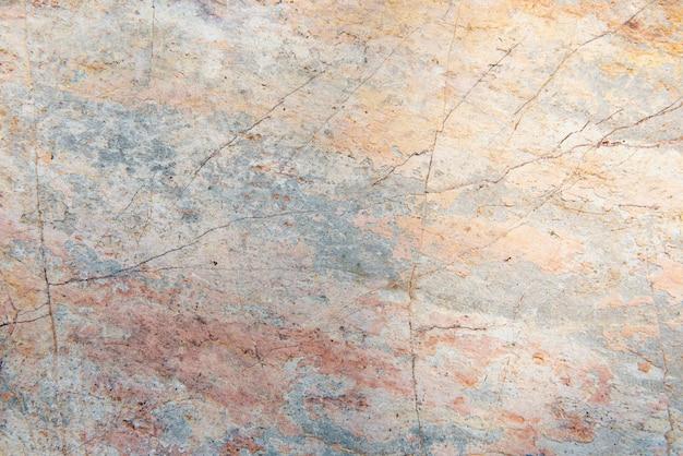 Pęknięty pastelowy kolor cementu teksturowane tło