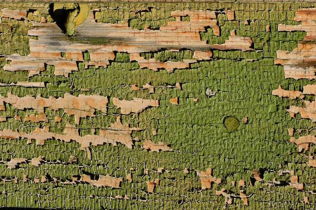 Pęknięty wyblakły stary zielony malowany tekstura drewniana deska,