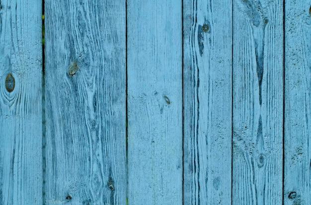 Pęknięty wyblakły zielony i niebieski malowane drewniane deski tekstury