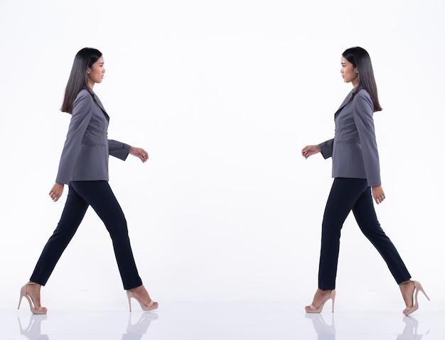 Pełna długość snap figure, azjatycka kobieta biznesu spacery w niebieskich formalnych spodniach i butach na wysokim obcasie, studyjne oświetlenie na białym tle na białym tle, prawnik szef akt pozowanie kolaż grupowy