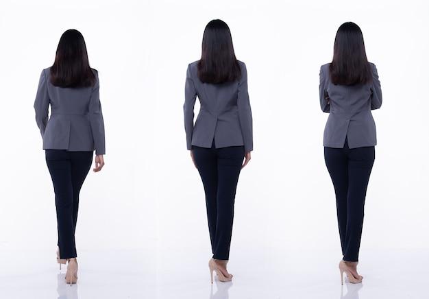 Pełna długość snap widok z tyłu, azjatycki biznes kobieta stoisko w niebieskim formalnym właściwym garniturze spodnie i buty na wysokim obcasie, oświetlenie studyjne na białym tle na białym tle, prawnik szef akt pozowanie kolaż grupowy
