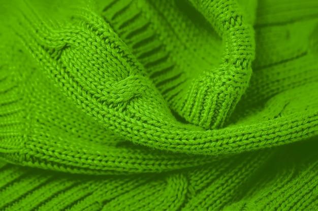 Pełna klatka zdjęcia tła świeżego zielonego dzianiny