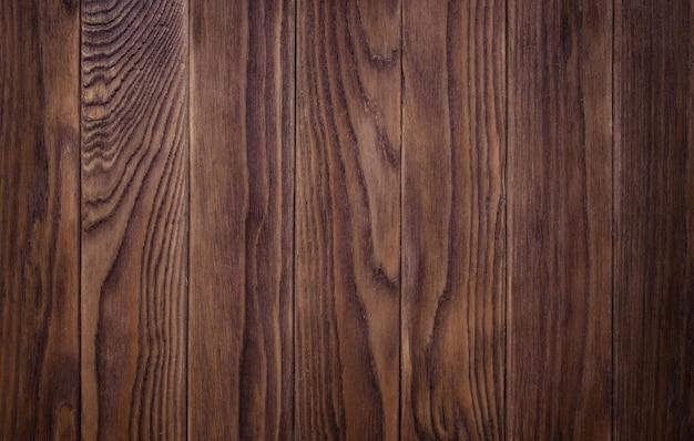 Pełna strona z teksturą drewnianej deski podłogowej poplamionej na ciemno, postarzanej