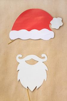 Photo booth kolorowe rekwizyty na przyjęcie świąteczne - wąsy, święty mikołaj, kapelusz