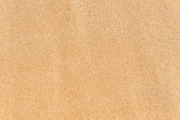 Piasek tekstura. brązowy piasek. widok z góry.