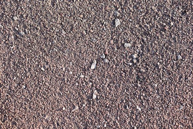 Piaskowaty tekstury tło z kopii przestrzenią