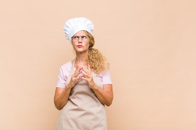 Piekarz w średnim wieku intryguje i spiskuje