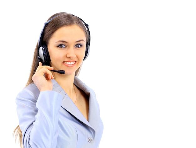 Piękna biznesowa kobieta w słuchawkach na białym tle