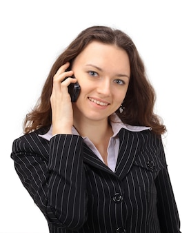 Piękna bizneswoman w telefonie na białym tle