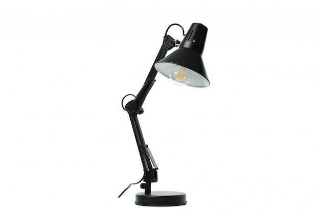 Piękna czarna stołowa lampa odizolowywająca na bielu