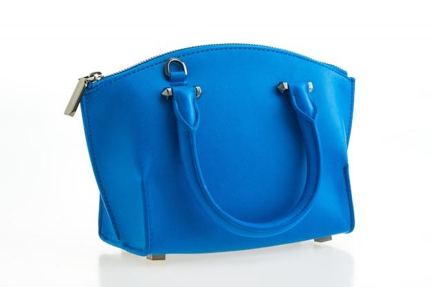 Piękna elegancja i luksusowa moda damska i niebieska torebka